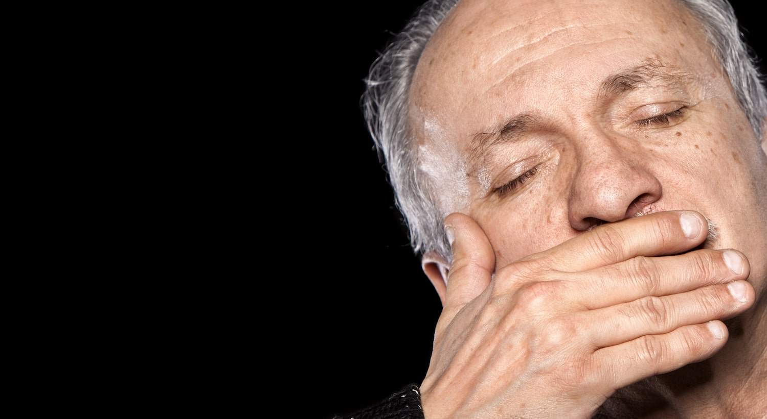 older-man-covering-mouth (1)